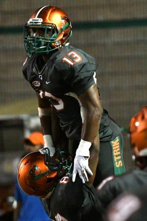 FAMU running back Bishop Bonnett is lifted up in celebration after scoring a touchdown versus Savannah State.