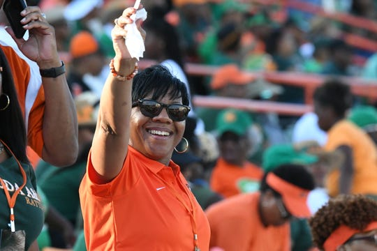 FAMU fans are all smiles and ready for homecoming day at Bragg Memorial Stadium.
