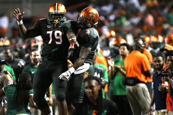 Tarique Akbar (left) and Azende Rey jump for joy seeing FAMU beat Savannah State.