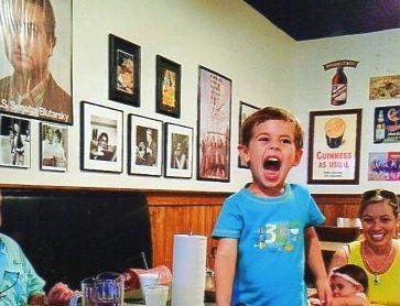 Grandson Jacob's first encounter with a MoMo's large pizza! Wow!