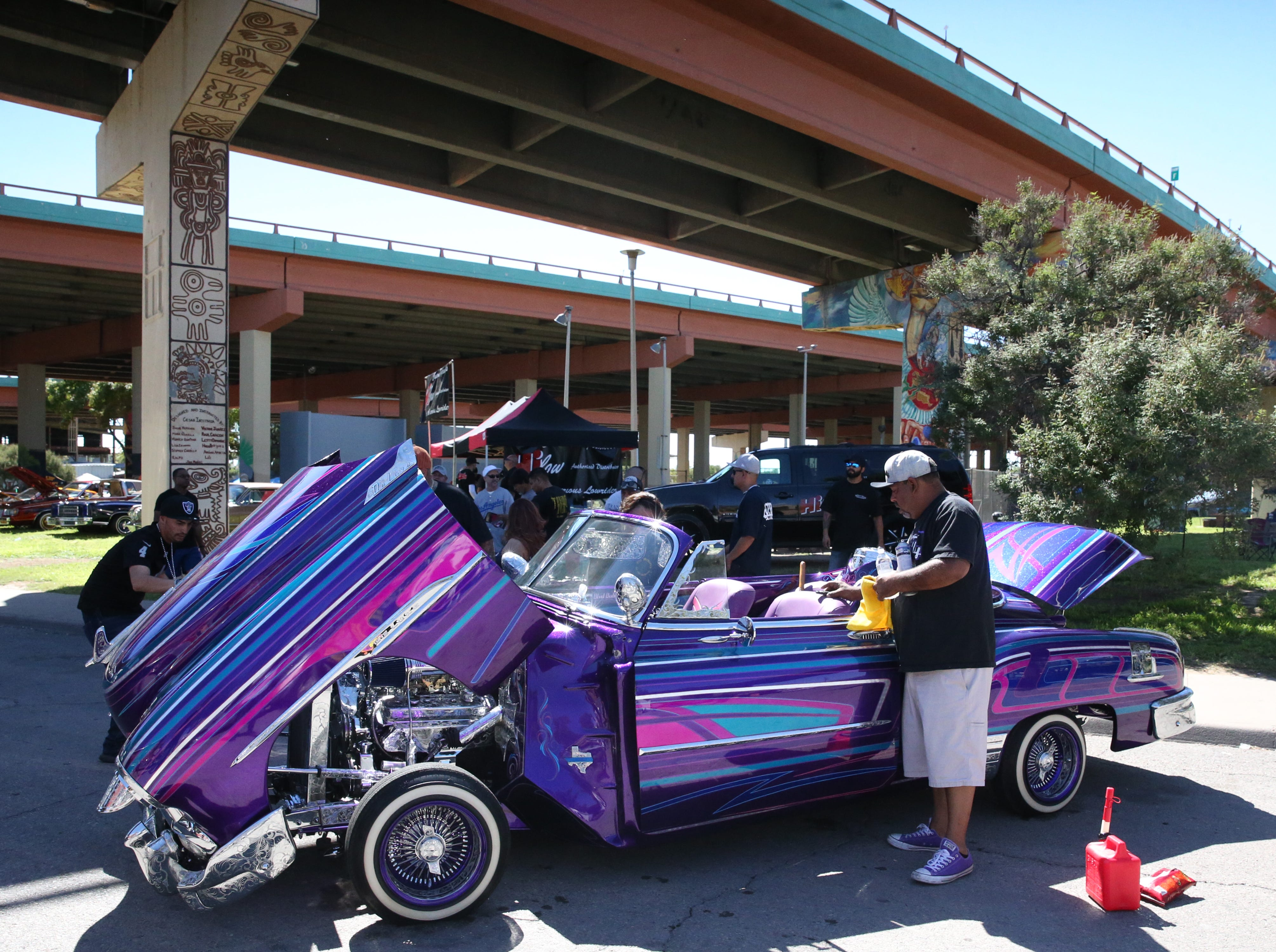 Chris Melendez of Odessa, TX shines up his customized 1951 Chevrolet Deluxe named 'Blvd. Bully' Sunday at Lincoln Park.