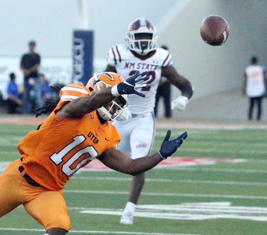 UTEP wide receiver Warren Redix, 10, can't reach a long throw that was just off the mark Saturday against NMSU..