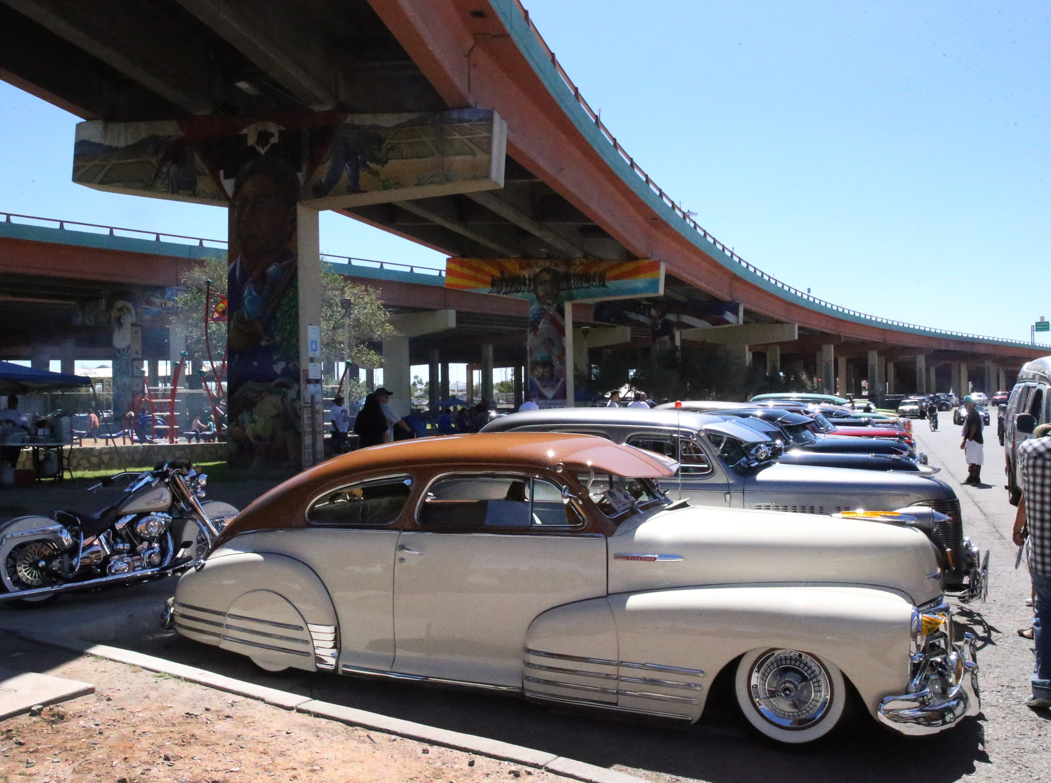 Lowriders under the overpasses at Lincoln Park Sunday.