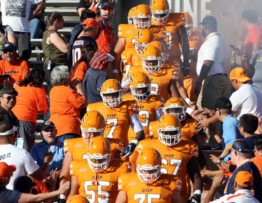 The UTEP Miners exit the Mine Shaft at the start of their game against I-10 rival New Mexico State University on Sept. 22.