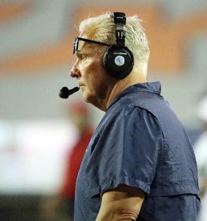 UTEP head football coach Dana Dimel watches the action on the field late in the third quarter Saturday.