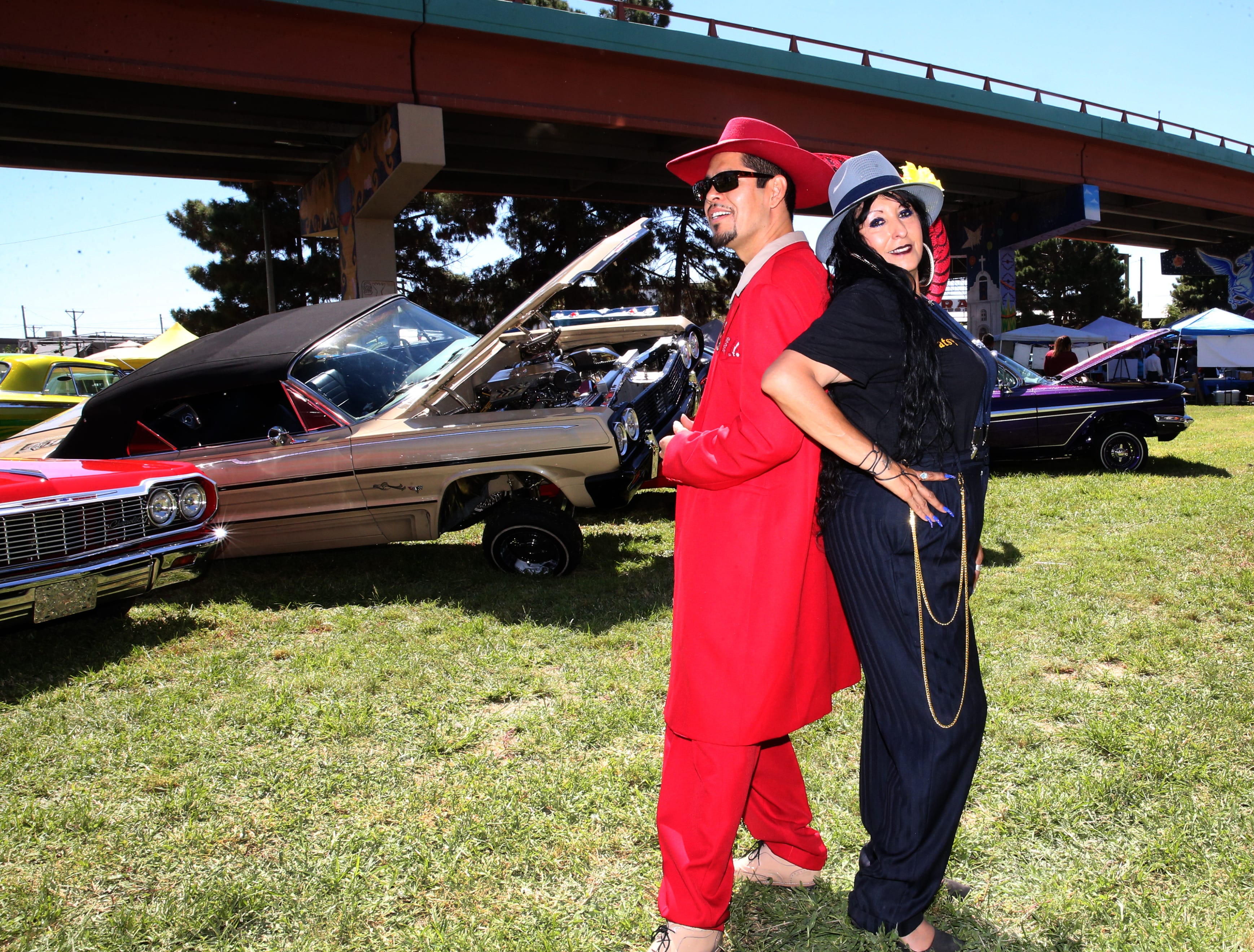 Francisco Perez and Patsy Sanchez in traditional Pachuco and Pachuca outfits Sunday.