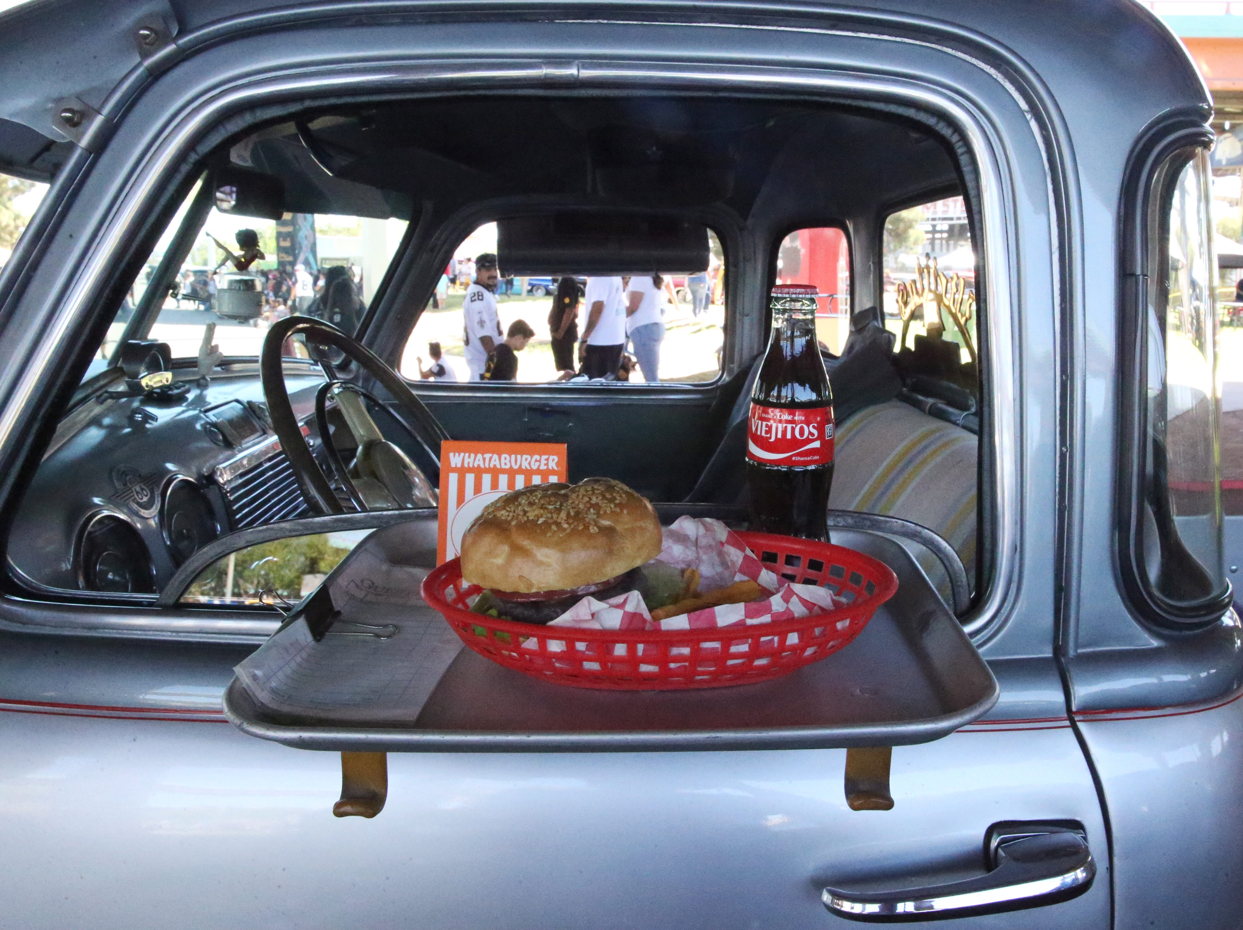 Burgers and fries at the drive-in window on this classic Chevy pickup truck.