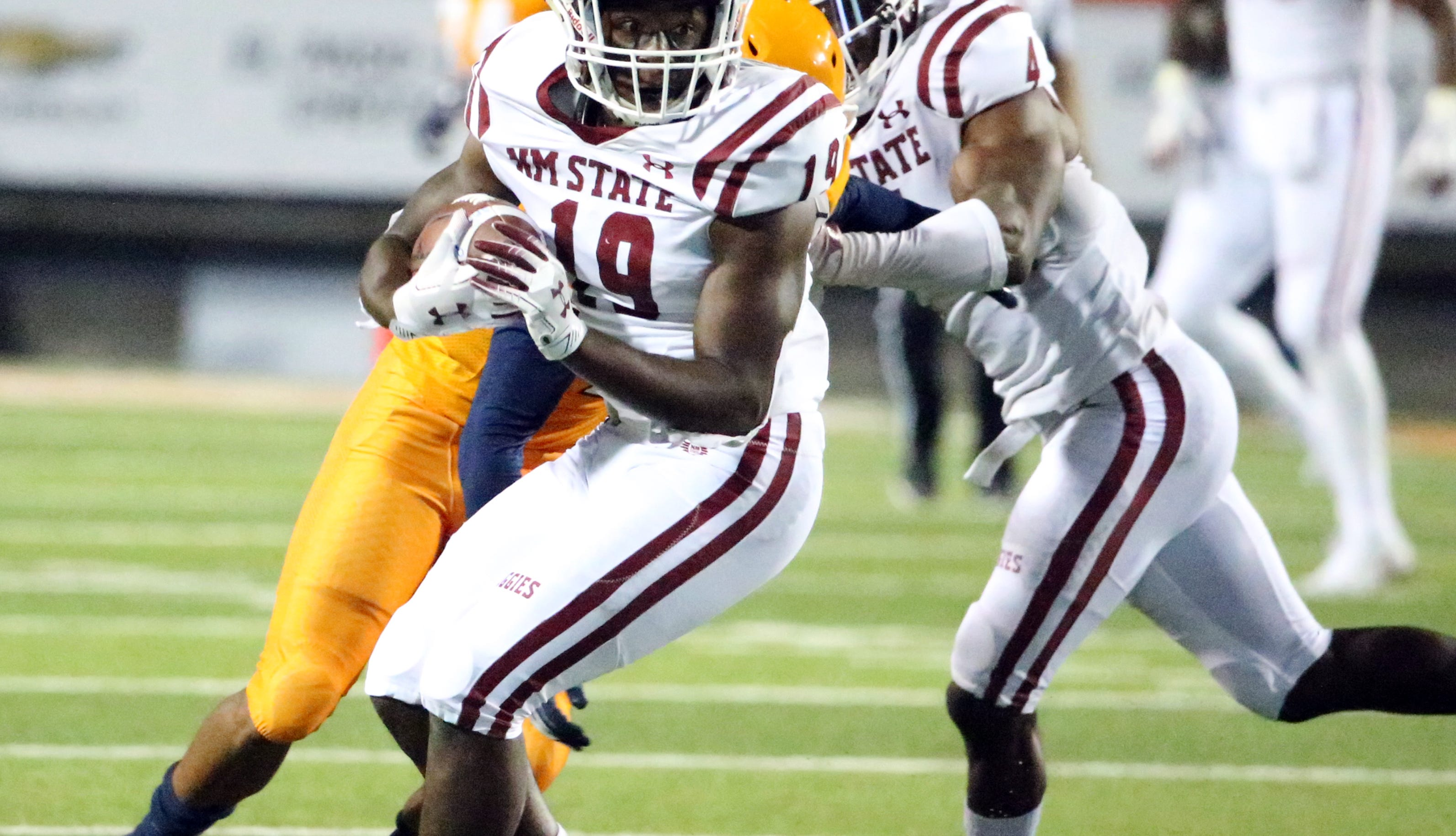 NMSU defensive back Austin Perkins, 19, comes down with an interception with less than a minute left in the game to end UTEP's efforts to even the score Saturday night in the Sun Bowl Stadium. The Aggies prevailed in the I-10 Rivalry 27-20.