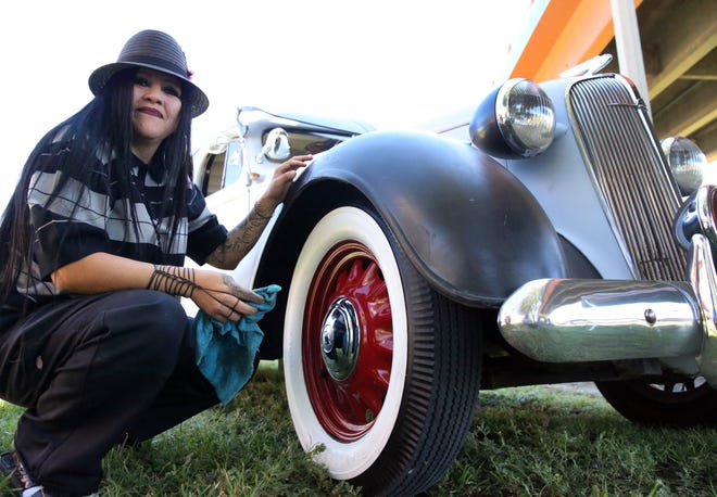 Monica 'La Moni' Sanchez of El Paso cleans the tires on her 1936 Chevrolet Deluxe under the overpasses at Lincoln Park Sunday.