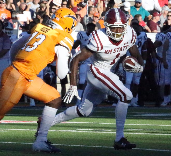 NMSU running back Jason Huntley, 1, finds an opening in the UTEP defense Saturday in the Sun Bowl Stadium.
