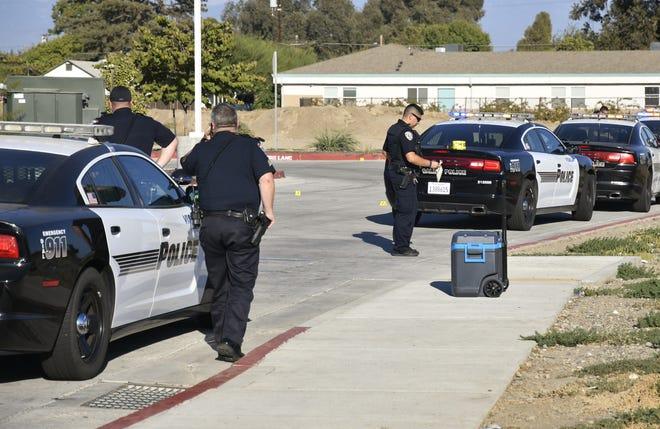 Visalia police investigate an officer-involved shooting near Arco near Lovers Lane on Saturday, Sept. 22.