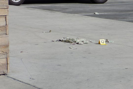 Cash left behind at the scene of an officer-involved shooting in front of Arco in Visalia.