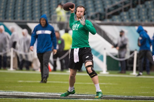 Eagles quarterback Carson Wentz, wearing a knee brace, warms up before his first start back from injury against the Colts on Sept. 23 at Lincoln Financial Field.