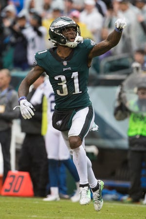 Eagles' Jalen Mills celebrates a defensive stop Sunday at Lincoln Financial Field. The Eagles defeated the Colts 20-16.