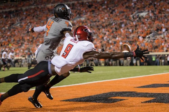 Texas Tech's T.J. Vasher couldn't haul in this pass, but the former Rider standout did have a TD catch against Oklahoma St.