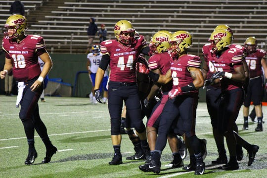 Midwestern State celebrates another big play as the No. 7 Mustangs took down Angelo State, 57-36, to improve to 2-0 in the Lone Star Conference.