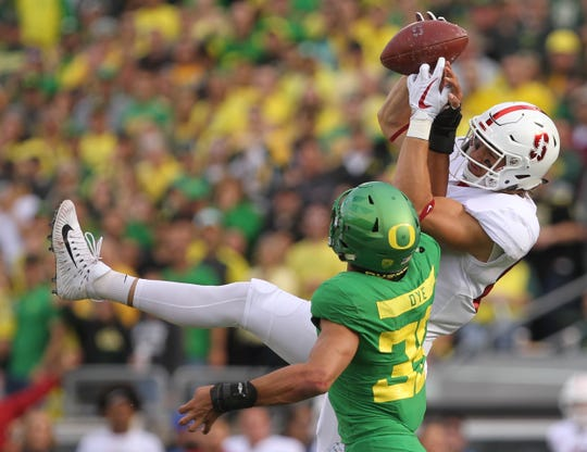 Oregon Ducks cornerback Charles Sudduth (36) breaks up a pass to Stanford Cardinal tight end Colby Parkinson (84)  in the first half at Autzen Stadium.