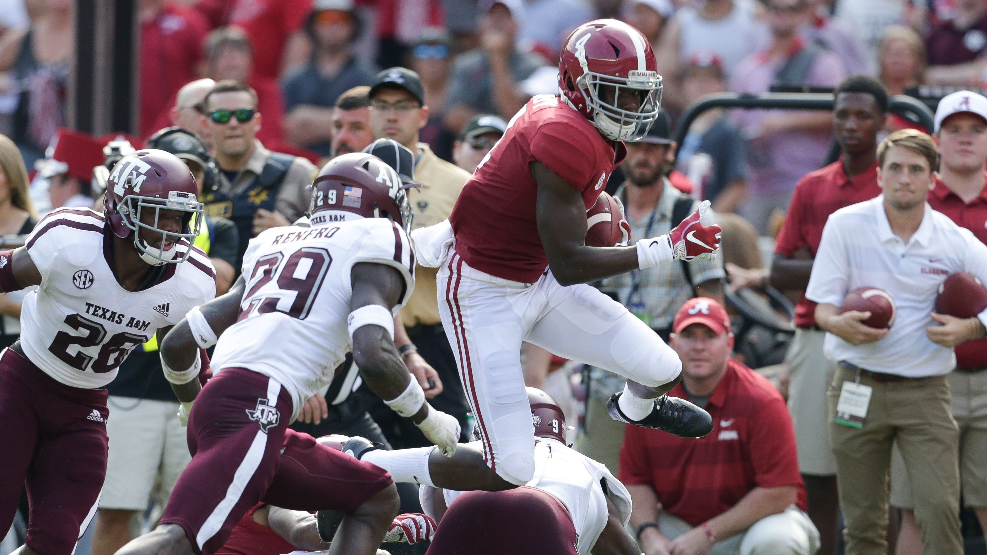 Alabama wide receiver Jerry Jeudy leaps past a Texas A&M defenders during their game at Bryant-Denny Stadium.