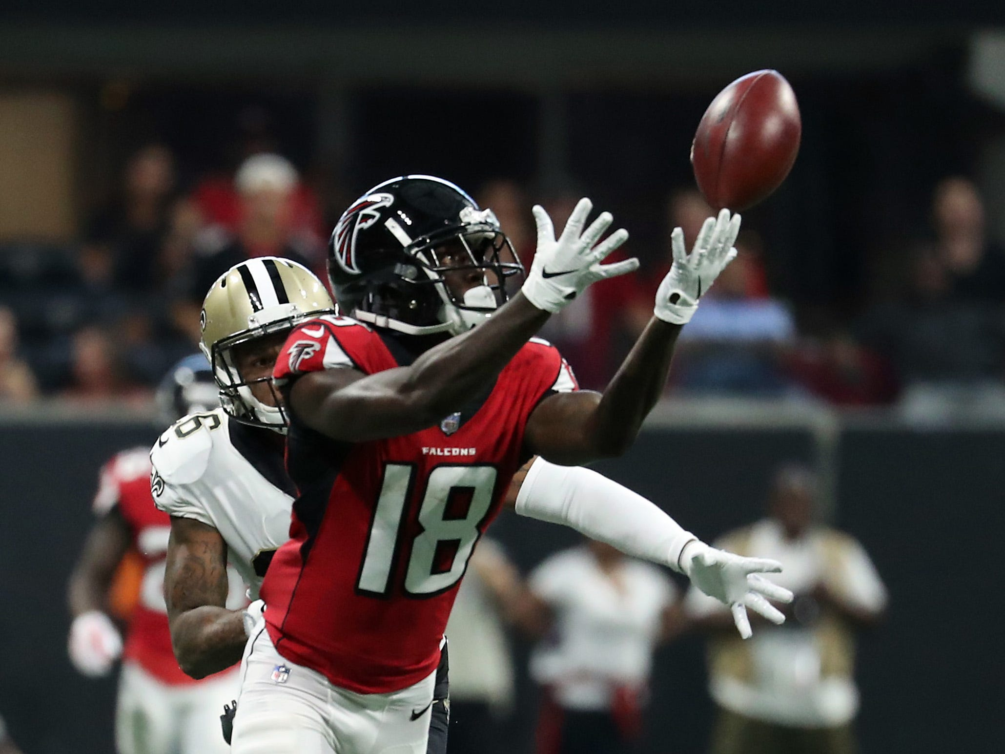 Atlanta Falcons wide receiver Calvin Ridley makes a long touchdown catch against New Orleans Saints cornerback P.J. Williams in the second quarter at Mercedes-Benz Stadium.