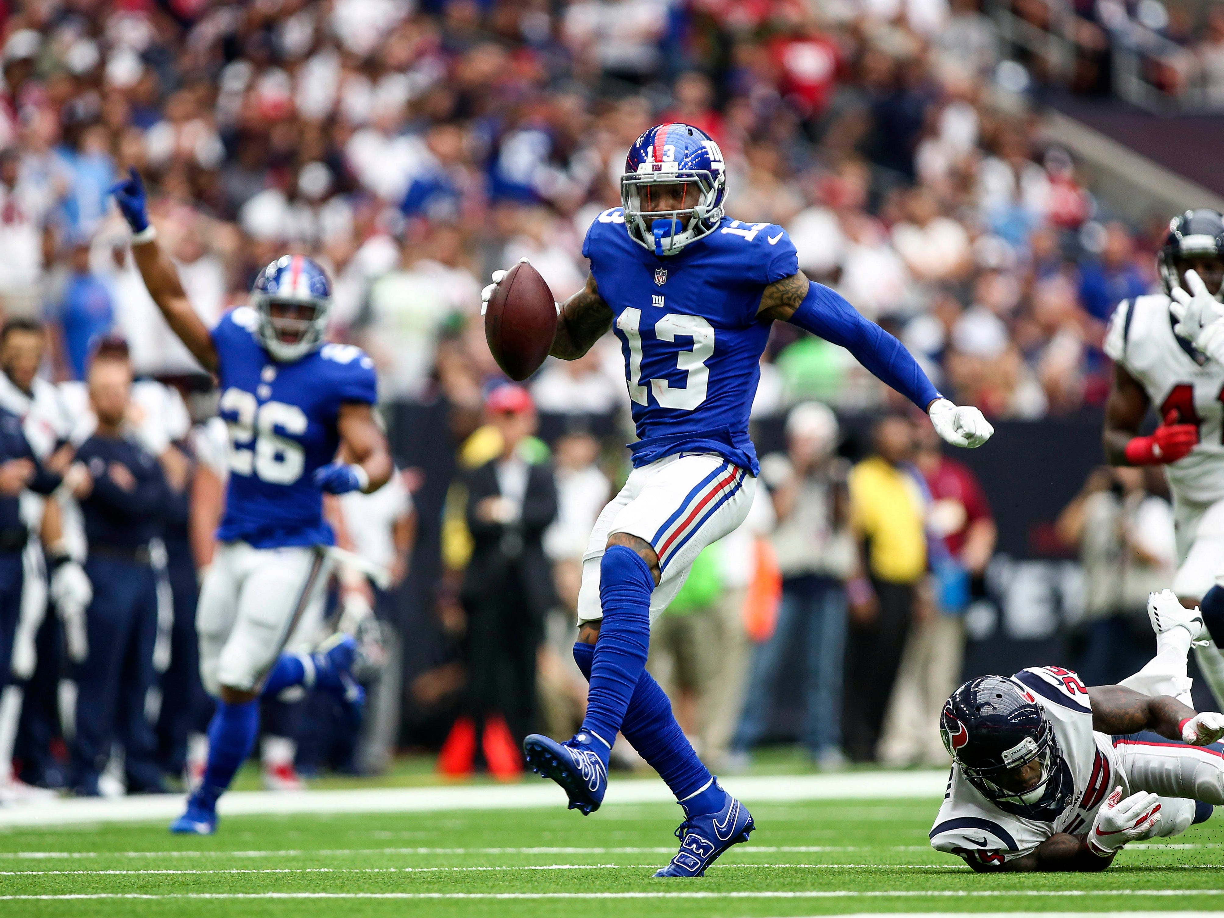 New York Giants wide receiver Odell Beckham runs with the ball during the second quarter against the Houston Texans at NRG Stadium.