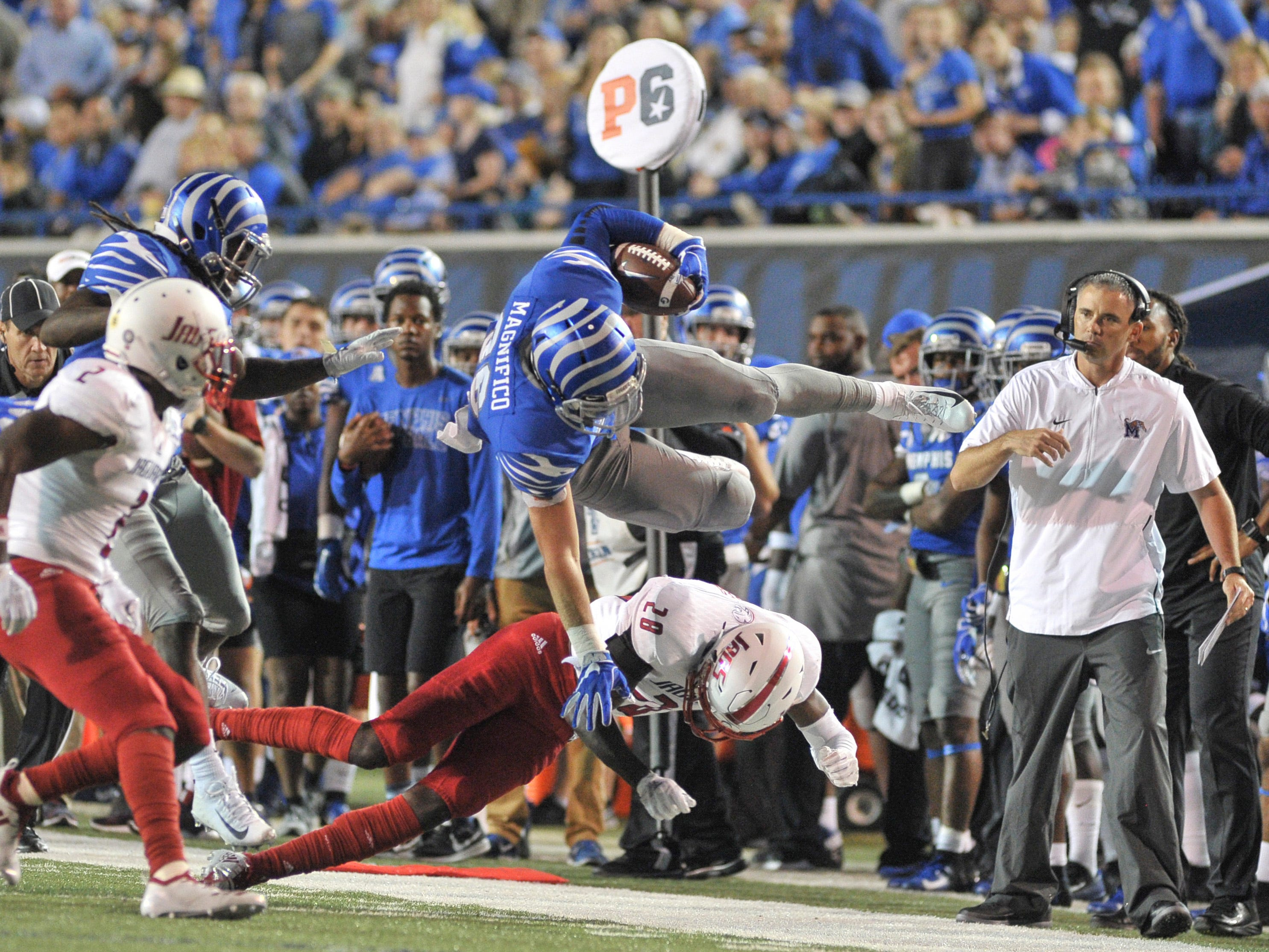 Memphis Tigers tight end Joey Magnifico (86) leaps over South Alabama Jaguars cornerback Travis Reed (28) during the first half at Liberty Bowl Memorial Stadium.