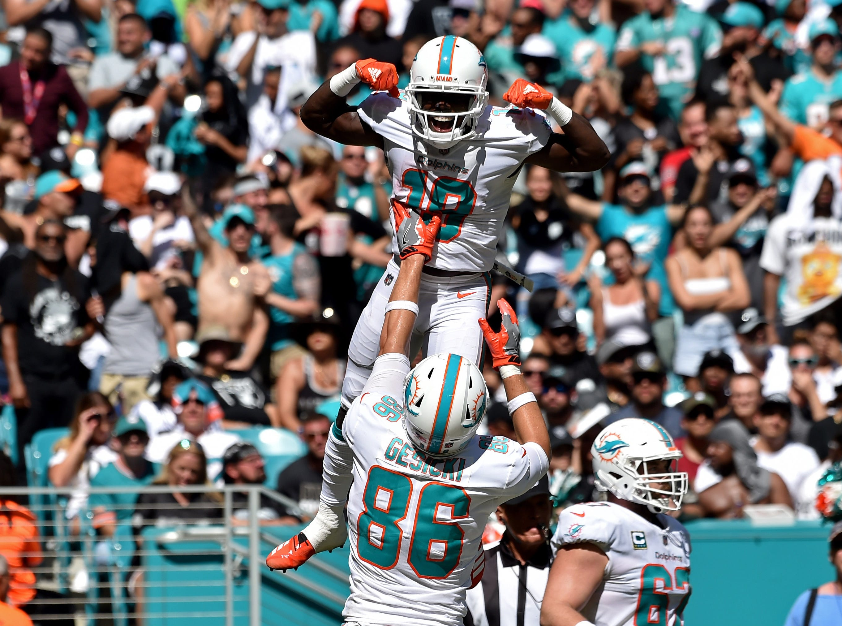 Miami Dolphins wide receiver Jakeem Grant celebrates with tight end Mike Gesicki after scoring a touchdown during the second half against the Oakland Raiders at Hard Rock Stadium.
