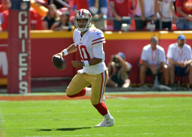 San Francisco 49ers quarterback Jimmy Garoppolo (10) drops back to pass during the first half against the Kansas City Chiefs at Arrowhead Stadium.