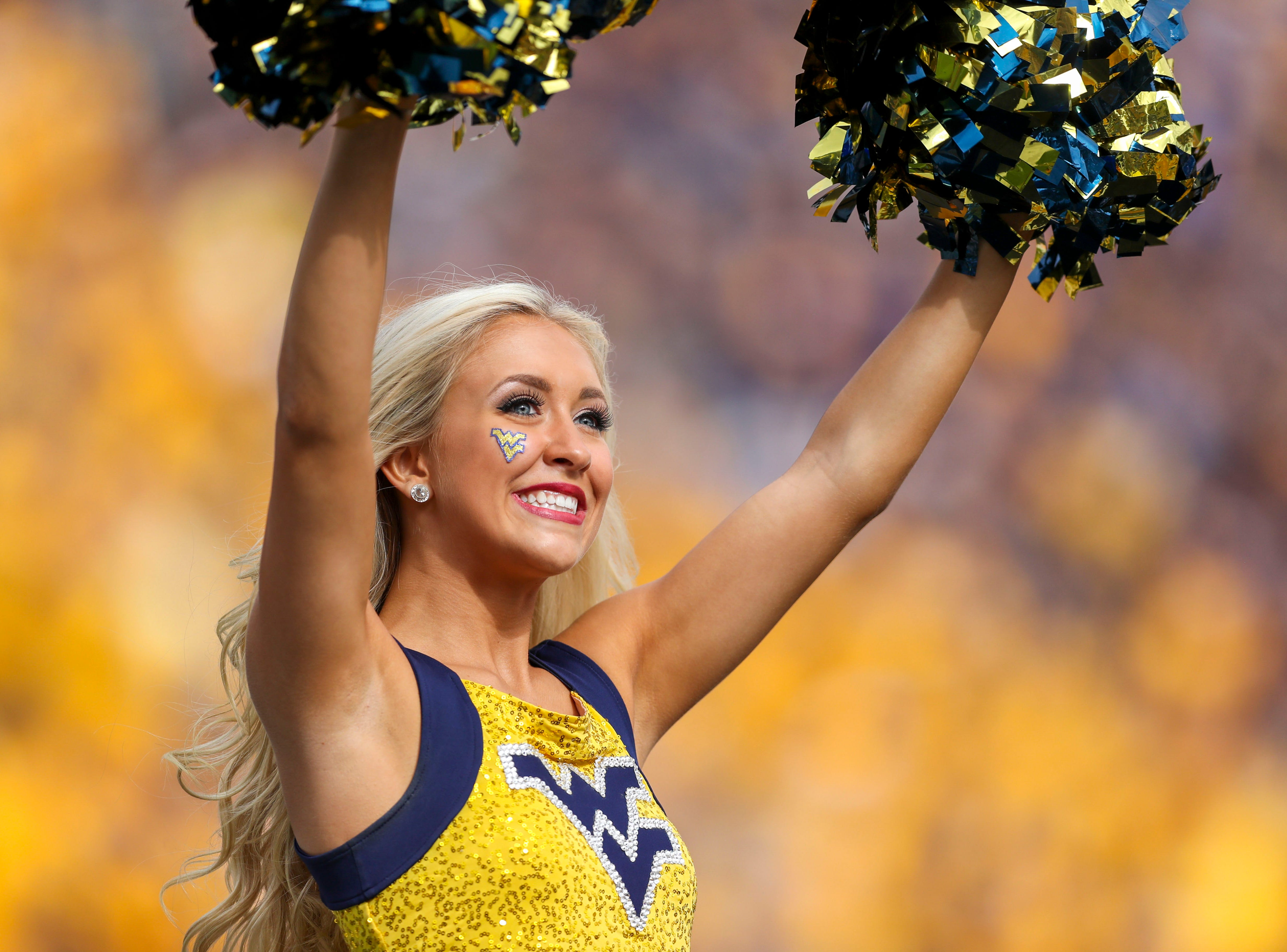 Week 4: A West Virginia Mountaineers cheerleader performs during the first quarter against the Kansas State Wildcats at Mountaineer Field at Milan Puskar Stadium.