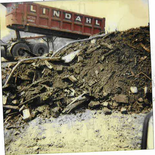 A truck dumps a load of construction debris in Chicago's North Lawndale neighborhood in 1990. (City of Chicago)