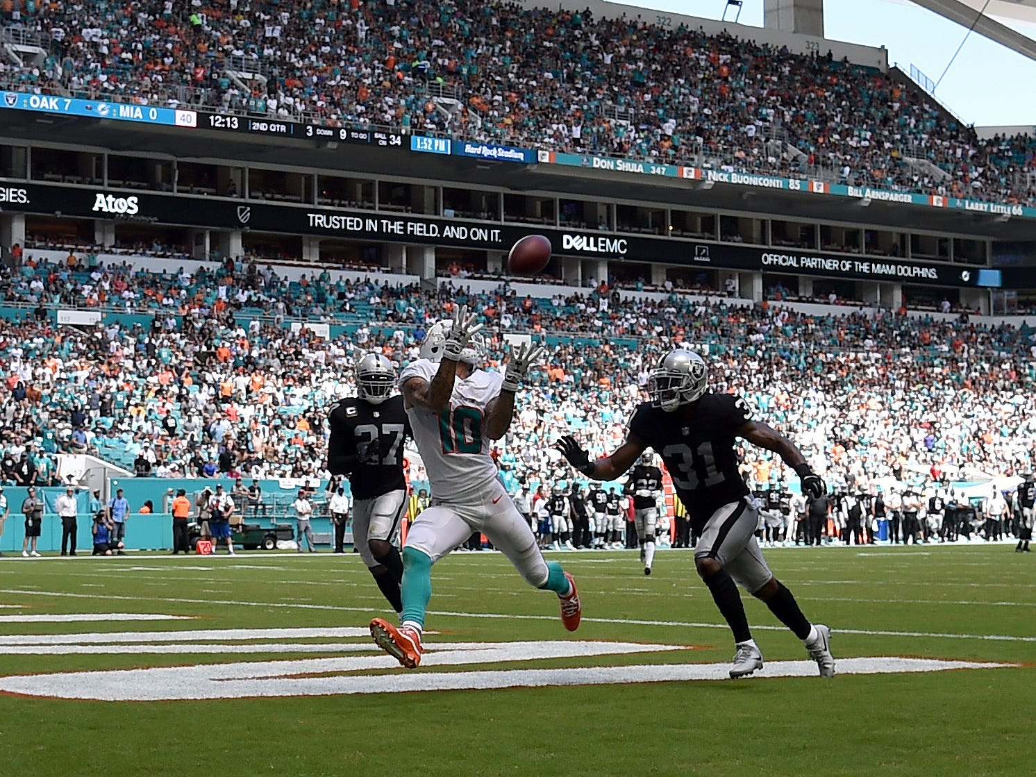 Miami Dolphins wide receiver Kenny Stills catches a pass for a touchdown against Oakland Raiders defensive back Marcus Gilchrist during the first half at Hard Rock Stadium.