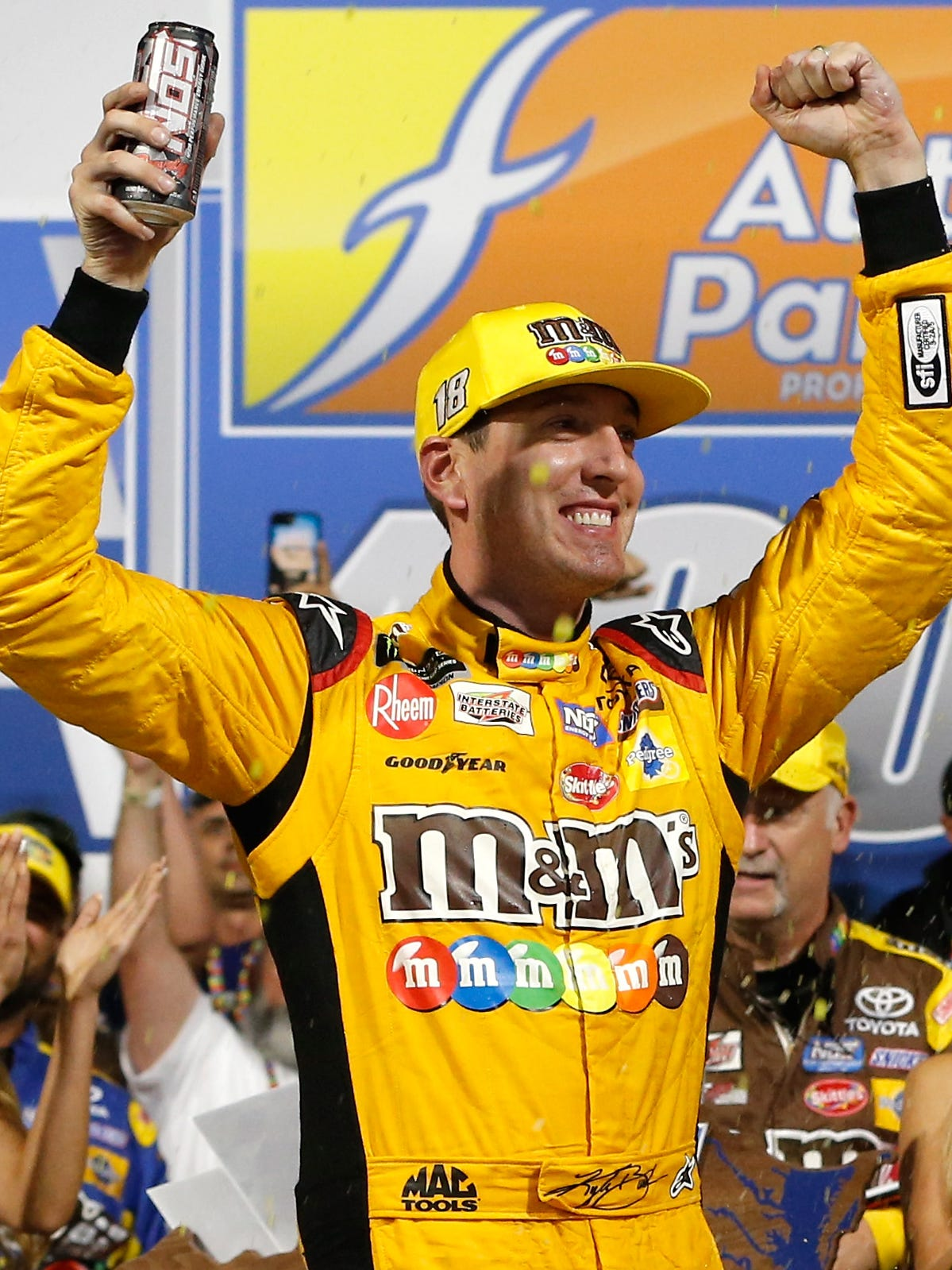 Kyle Busch celebrates in victory lane after winning the Monster Energy NASCAR Cup Series Federated Auto Parts 400 at Richmond Raceway.