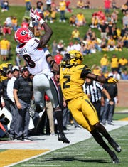 Georgia Bulldogs wide receiver Riley Ridley (8) catches a pass as Missouri Tigers defensive back DeMarkus Acy (2) defends in the second half at Memorial Stadium/Faurot Field.