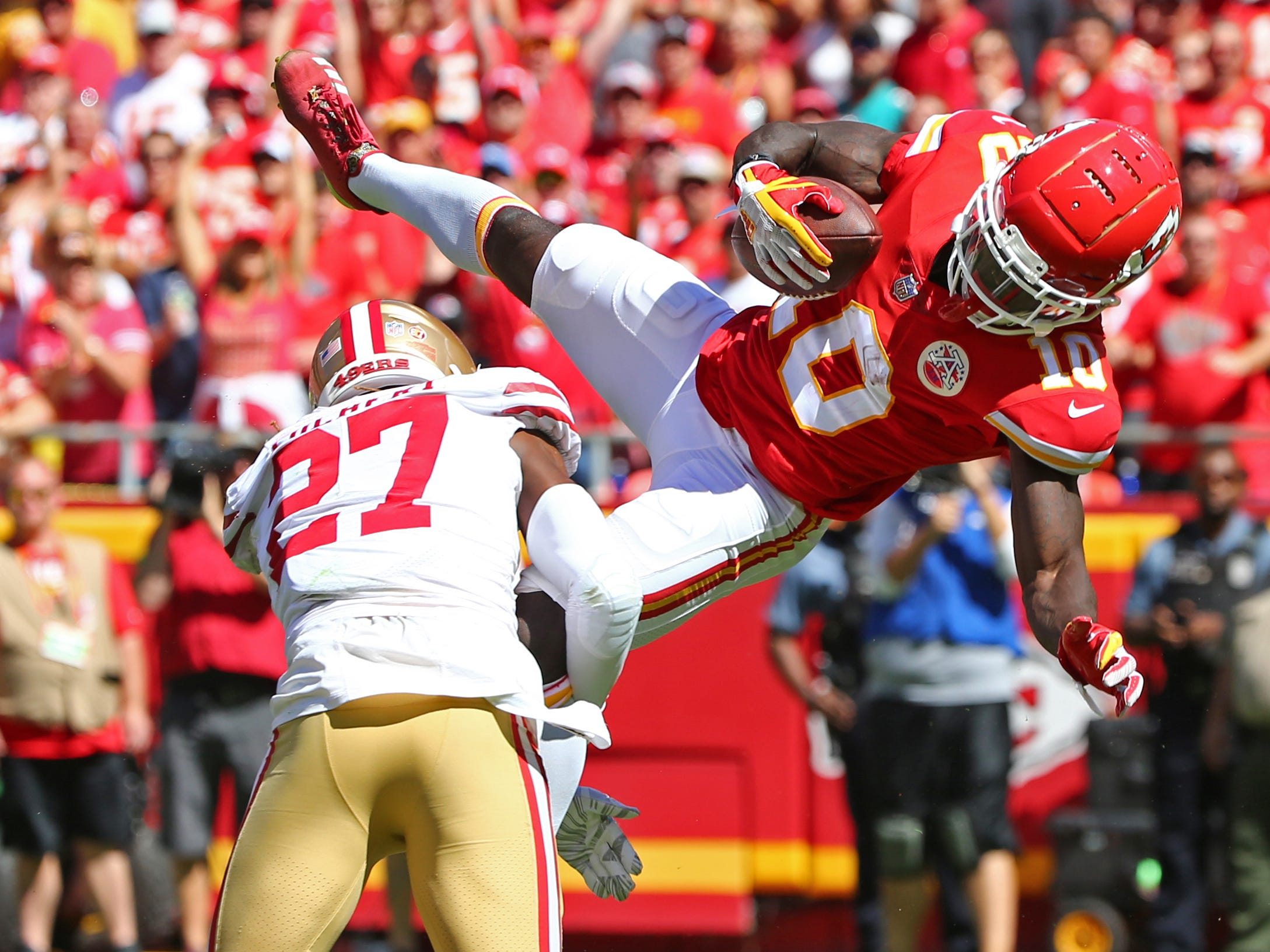 Kansas City Chiefs wide receiver Tyreek Hill catches a pass as San Francisco 49ers cornerback Adrian Colbert defends in the first half at Arrowhead Stadium.