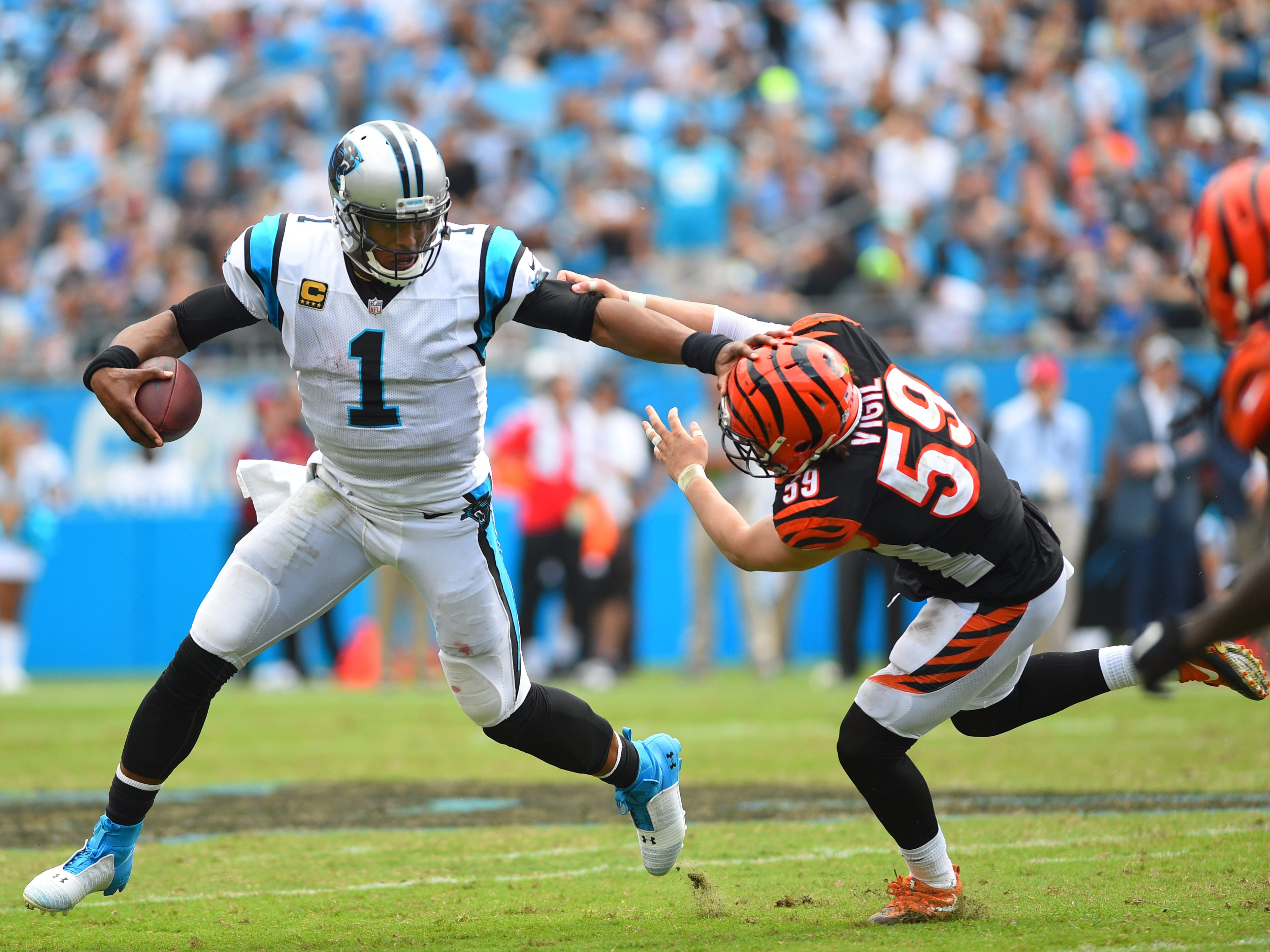 Sep 23, 2018; Charlotte, NC, USA; Carolina Panthers quarterback Cam Newton (1) with the ball as Cincinnati Bengals linebacker Nick Vigil (59) defends in the fourth quarter at Bank of America Stadium. Mandatory Credit: Bob Donnan-USA TODAY Sports