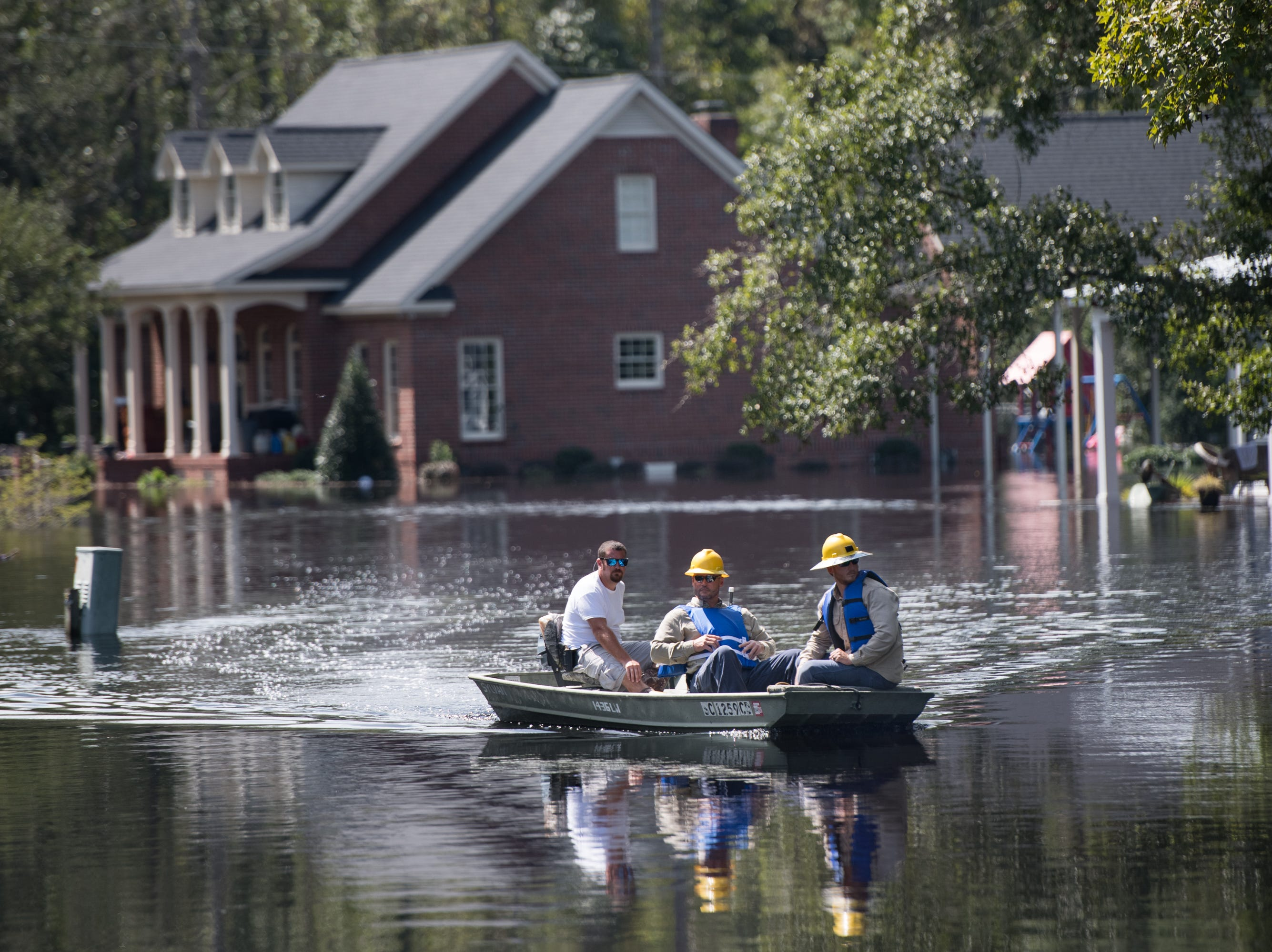 People navigate floodwaters caused by Hurricane Florence near the Waccamaw River on Sept. 23, 2018 in Conway, S.C.