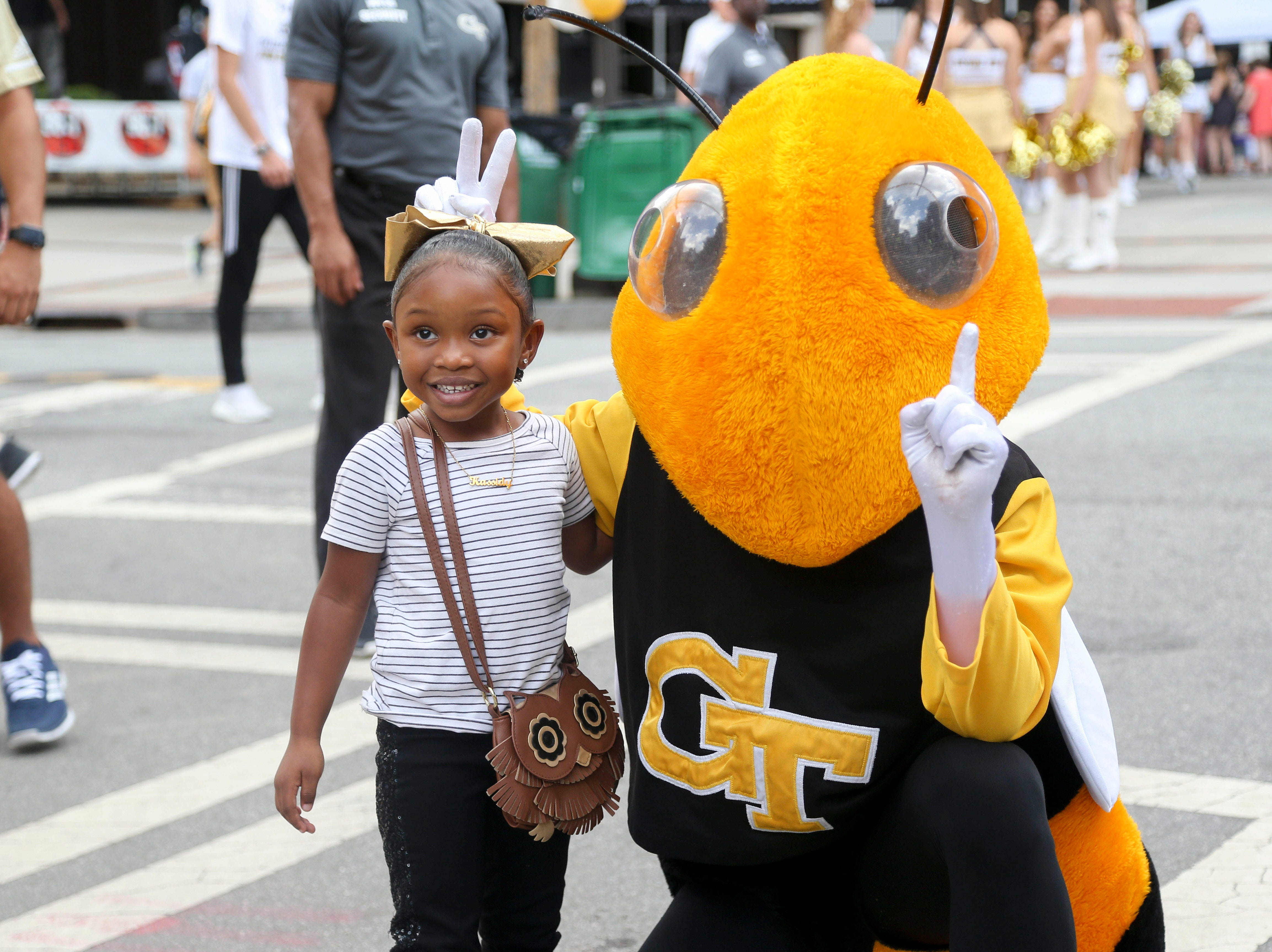 Week 4: Georgia Tech Yellow Jackets fan Kassidy Watkins has her picture taken with mascot Buzz before a game against the Clemson Tigers at Bobby Dodd Stadium.