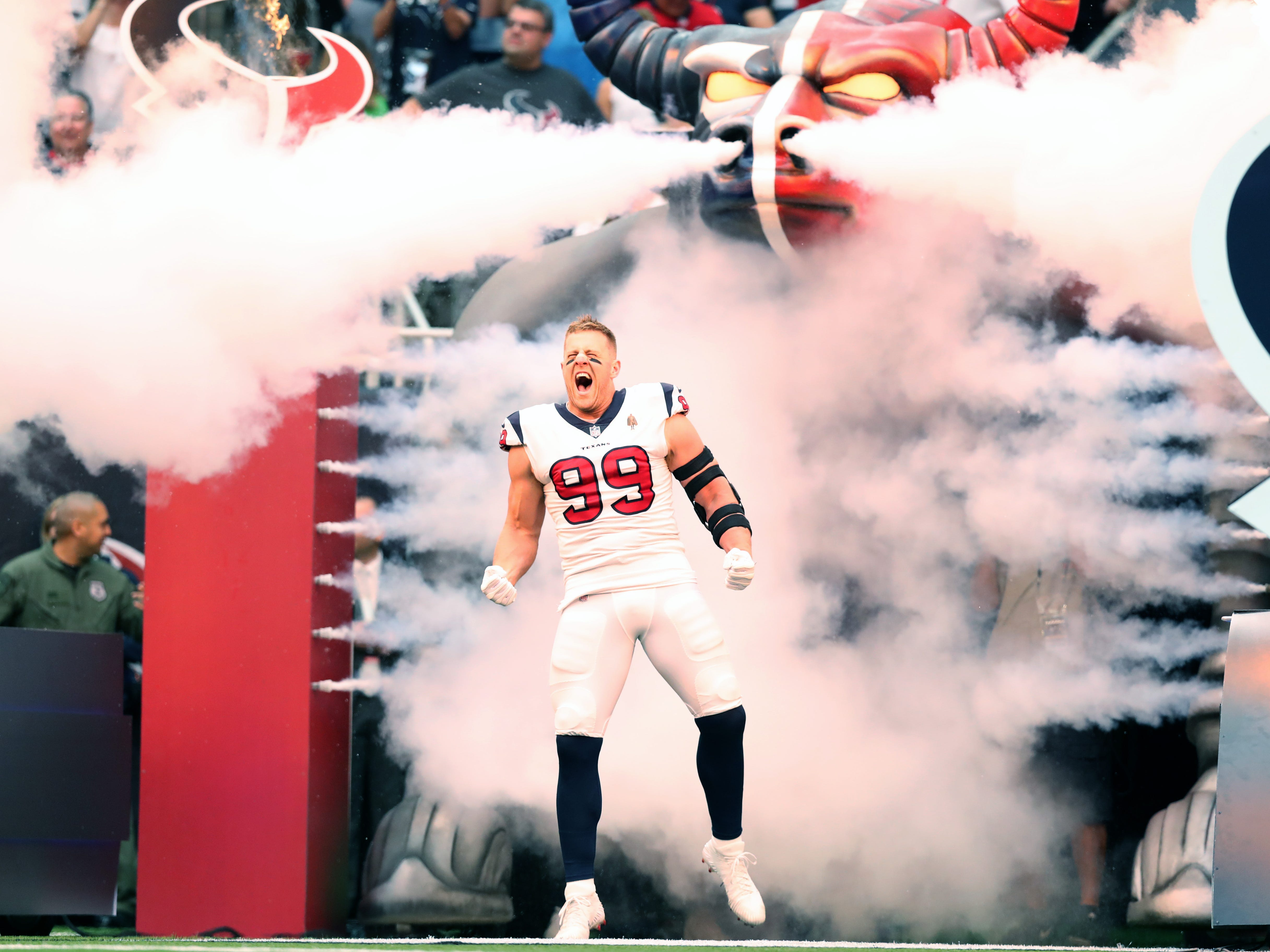 Houston Texans defensive end J.J. Watt screams as he is introduced prior to the kick-off against the New York Giants at NRG Stadium.