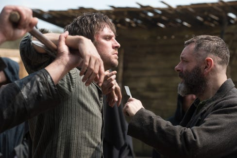 "Thomas (Dan Stevens, left) runs afoul of a cult leader (Michael Sheen) in the period horror film ""Apostle."""