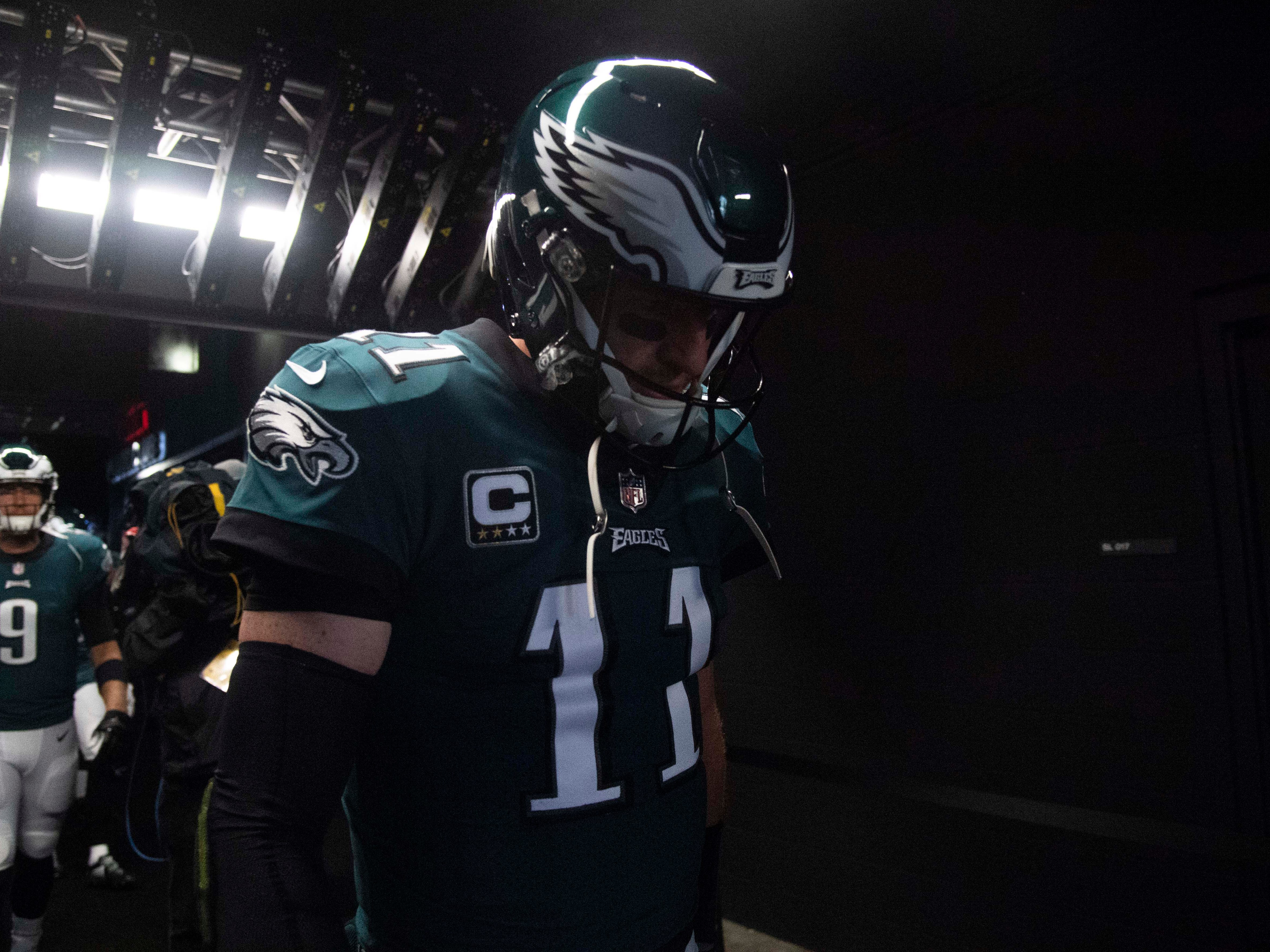 Philadelphia Eagles quarterback Carson Wentz walks out before the start of the game against the Indianapolis Colts at Lincoln Financial Field.