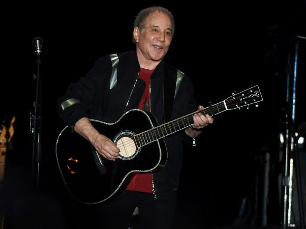 Paul Simon says farewell to touring with a giddy final show in Queens
