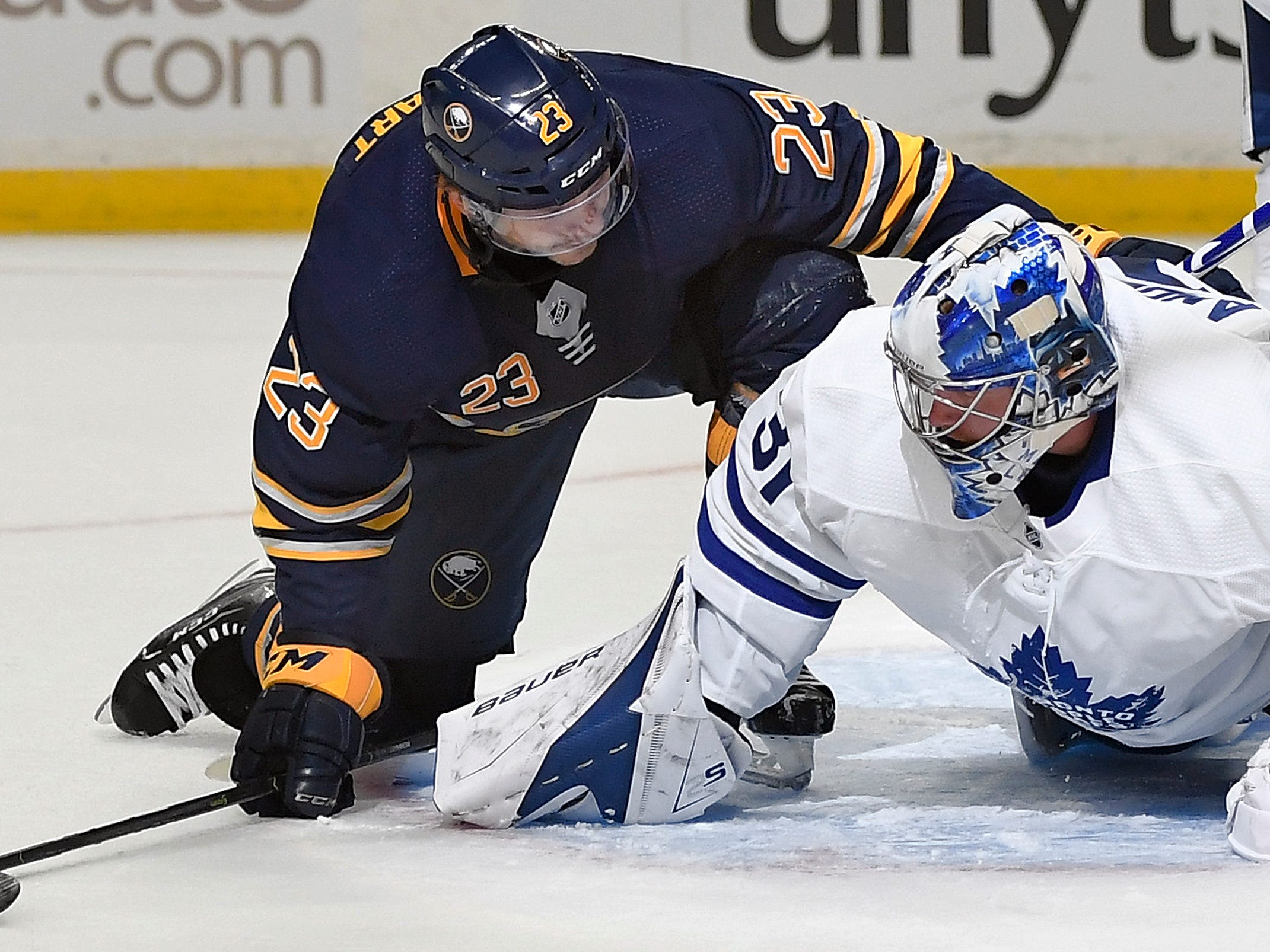 Sept. 22: Buffalo Sabres center Sam Reinhart checks on Toronto Maple Leafs goalie Frederik Andersen after a pileup in front of the net.