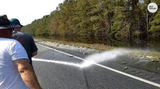 North Carolina fire fighters had to hose down Interstate 40 after Hurricane Florence pushed fish out of the ocean and onto the highway.