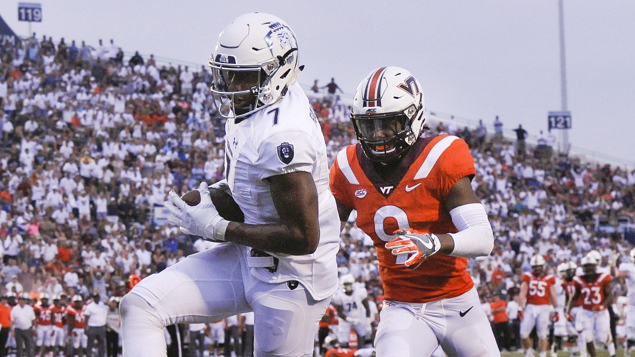 Old Dominion receiver Travis Fulgham (7) catches a second-half touchdown pass behind Virginia Tech defender Khalil Ladler (9).