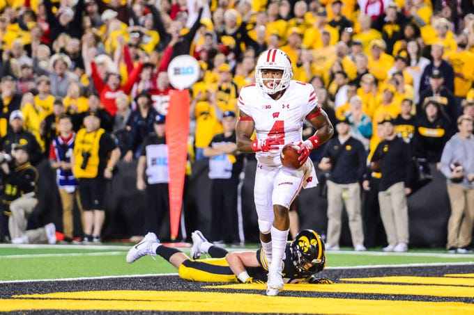Wisconsin Badgers wide receiver A.J. Taylor (4) catches a touchdown pass against the Iowa Hawkeyes during the fourth quarter at Kinnick Stadium.