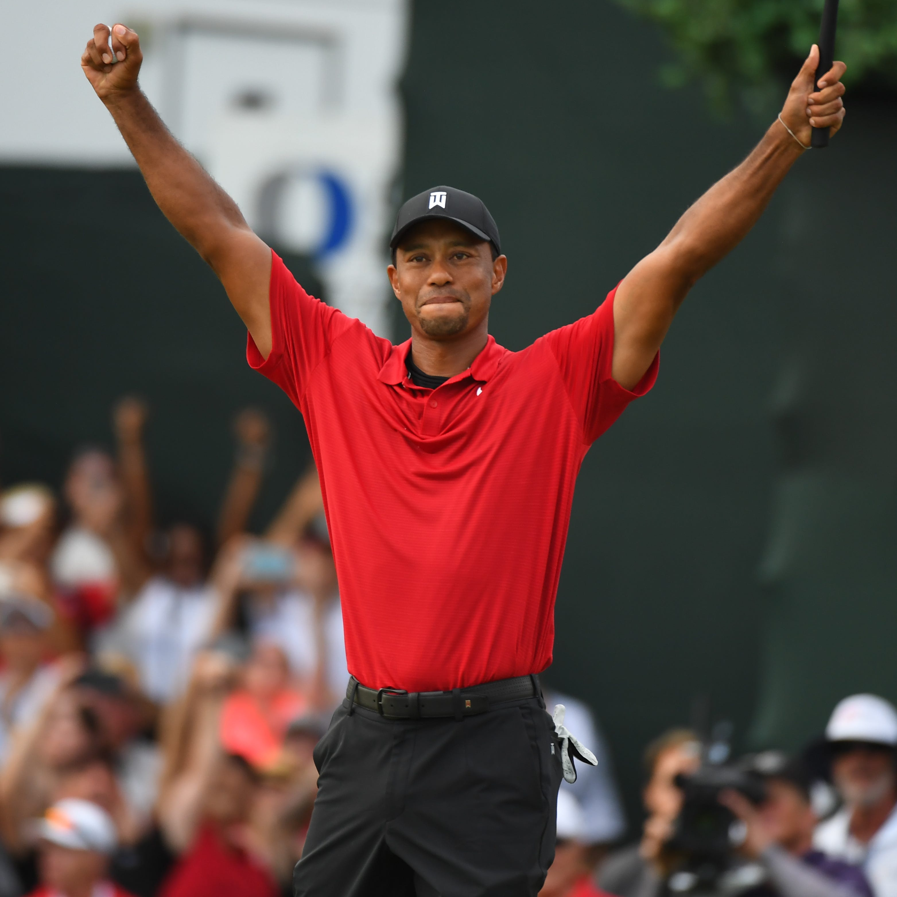 Tiger Woods reacts to winning the Tour Championship golf tournament at East Lake Golf Club.