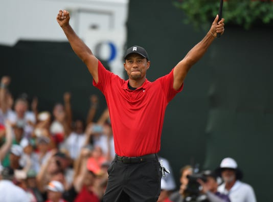 2018-9-23-tiger-woods-arms-up