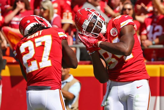Kansas City Chiefs tight end Demetrius Harris celebrates with running back Kareem Hunt after scoring a touchdown against the San Francisco 49ers in the first half at Arrowhead Stadium.