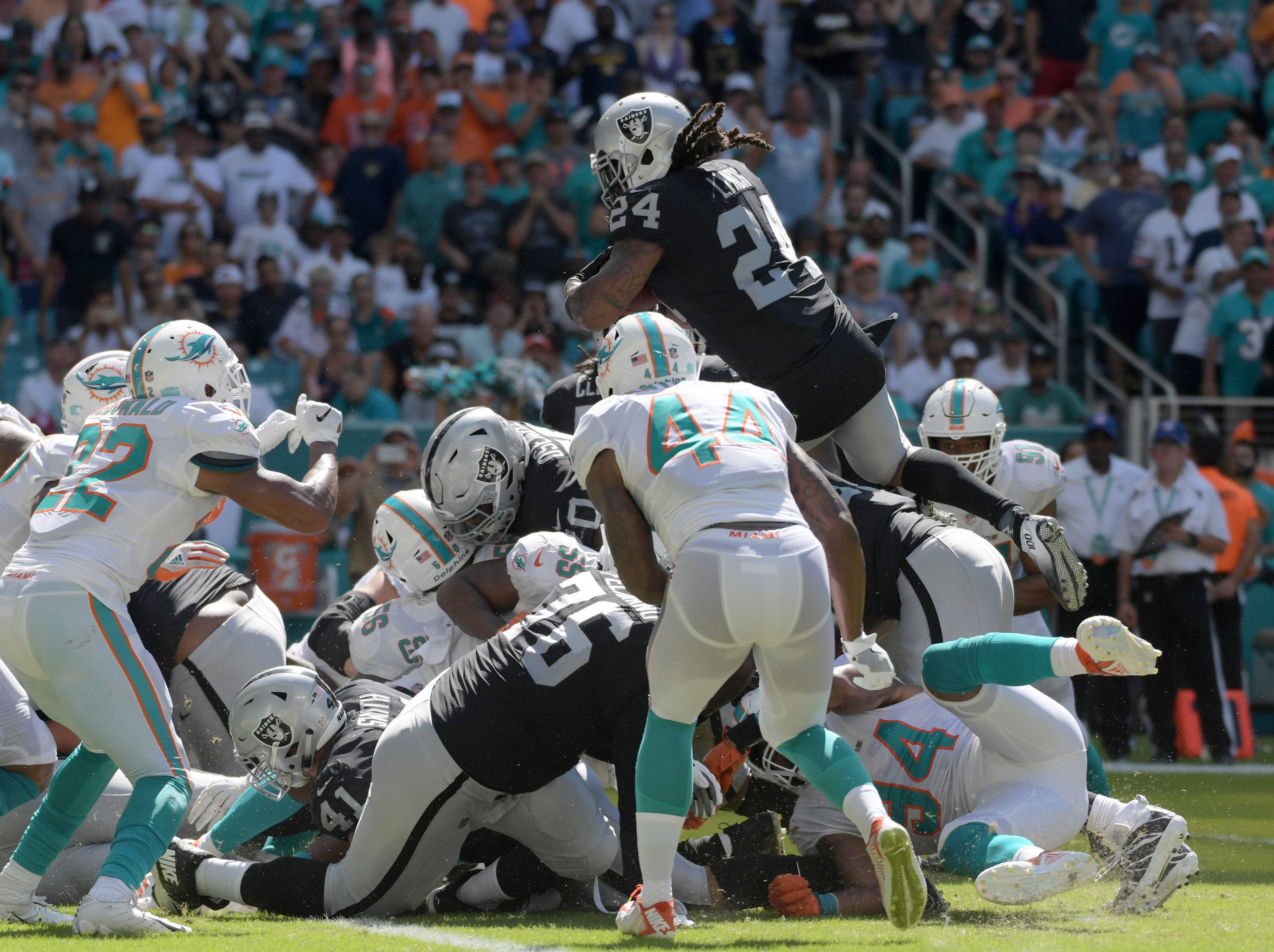 Oakland Raiders running back Marshawn Lynch scores on a one-yard touchdown run in the third quarter against the Miami Dolphins at Hard Rock Stadium.