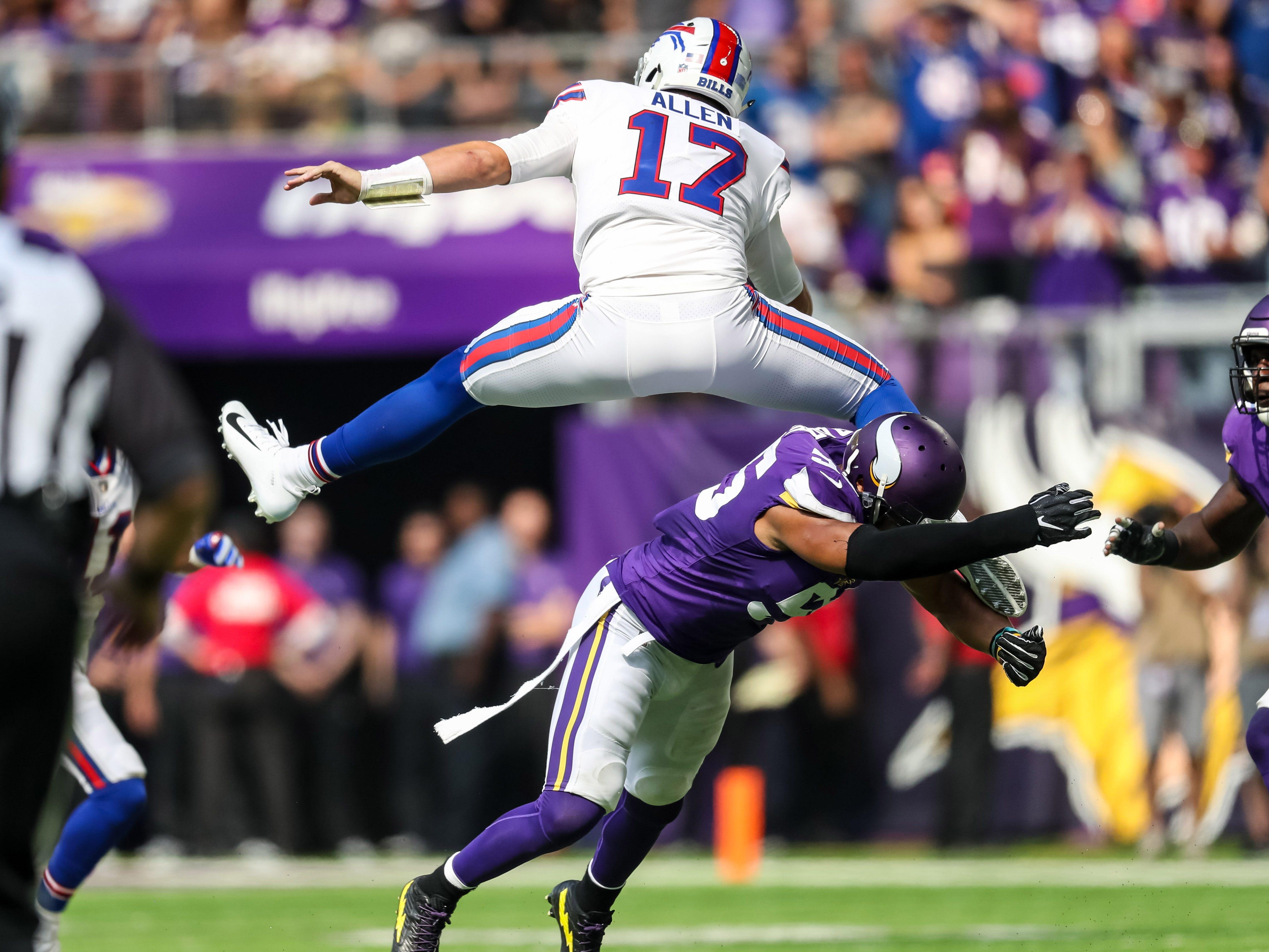 Buffalo Bills quarterback Josh Allen hurdles Minnesota Vikings linebacker Anthony Barr during the first quarter at U.S. Bank Stadium.