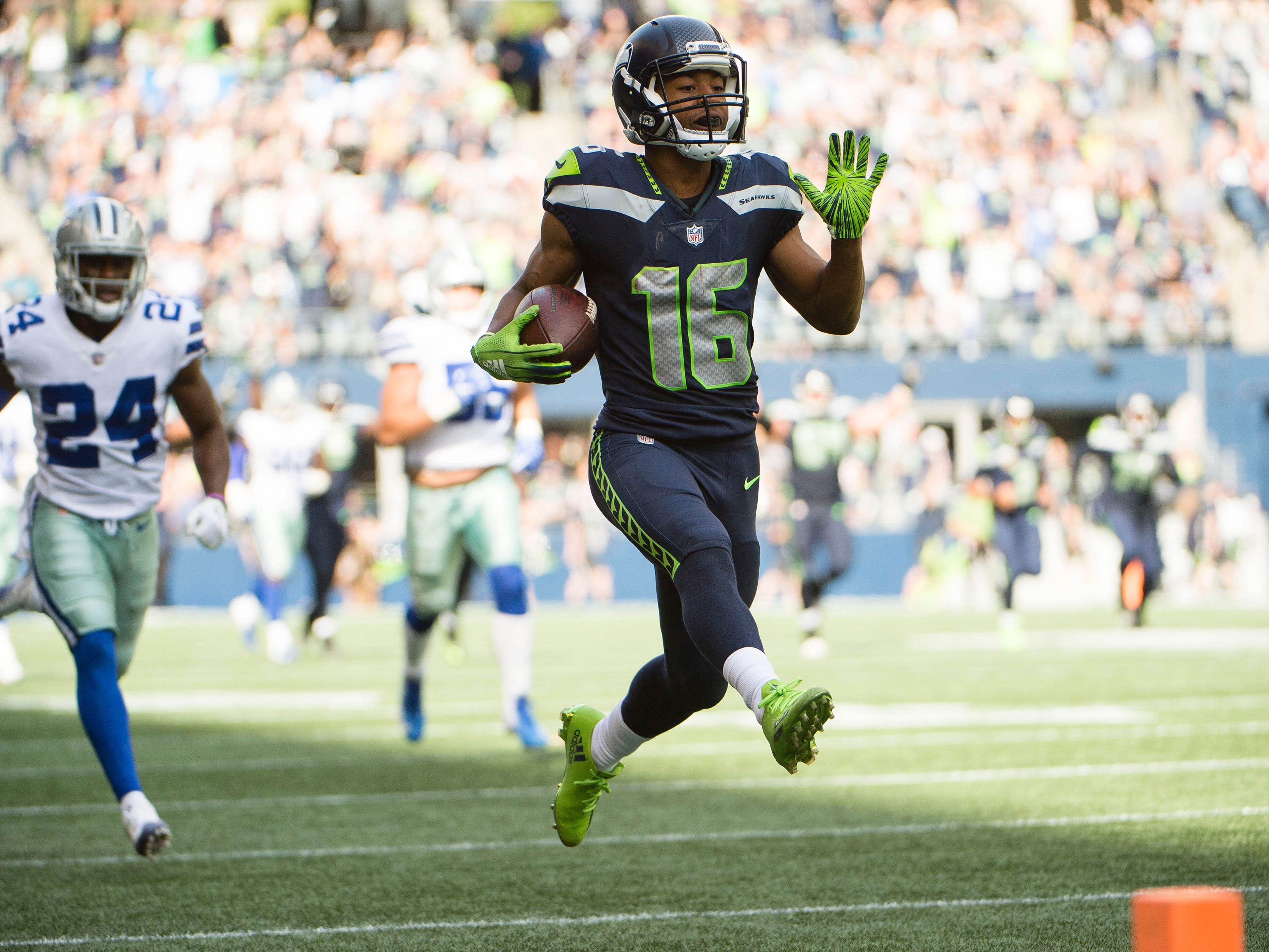 Sep 23, 2018; Seattle, WA, USA; Seattle Seahawks wide receiver Tyler Lockett (16) races past Dallas Cowboys cornerback Chidobe Awuzie (24) for a touchdown during the first half at CenturyLink Field. Mandatory Credit: Troy Wayrynen-USA TODAY Sports